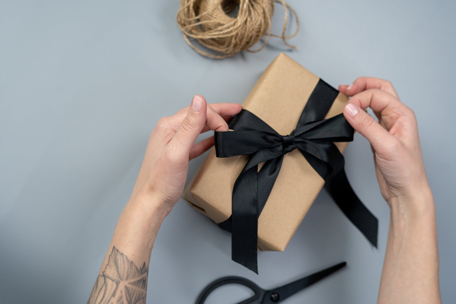 brown gift box with black ribbon wellness gift ideas