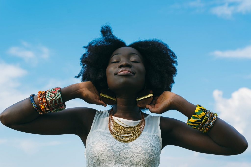 Beautiful black women with African style jewelry- support small black owned businesses